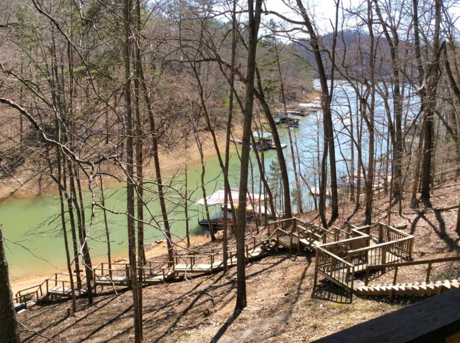 Relax on the patio deck with panoramic views of beautiful Norris Lake at Cove Pointe lake community