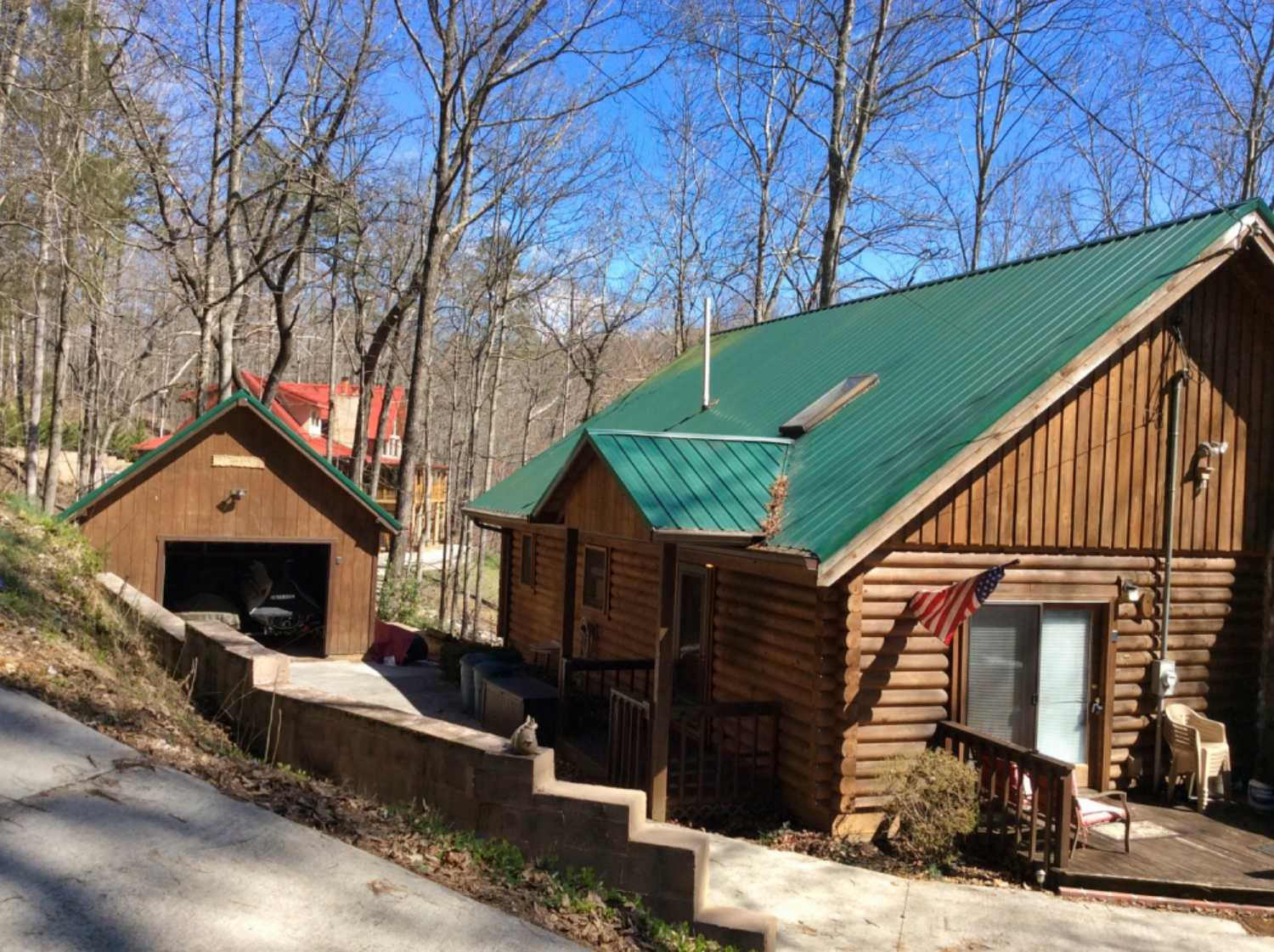 Lakefront log cabin with two car garage and plenty of space to entertain family and friends