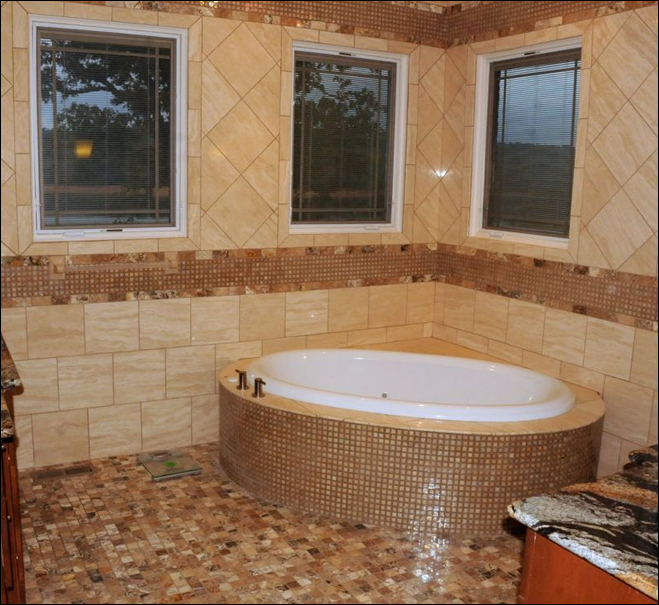 Custom all tile flooring from floor to ceiling and jacuzzi tub<