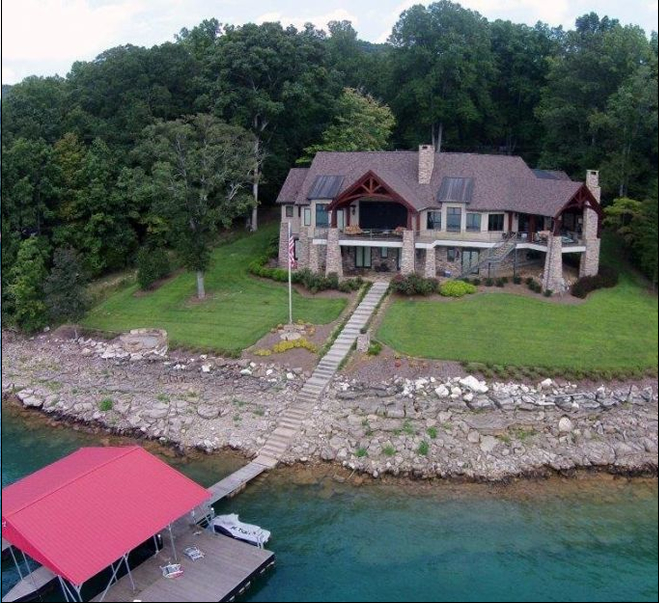Rear aerial view of lake home  on 1.07 acres offering privacy and seclusion on Norris Lake
