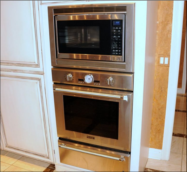Stainless Steel microwave and Thermador oven with drawer warmer