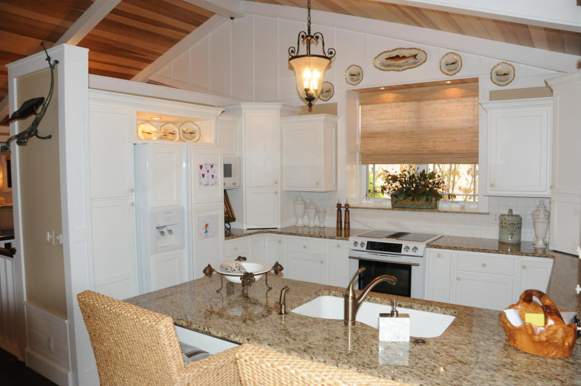 Gorgeous view of the kitchen with Granite counter-tops, all white appliances and cabinets