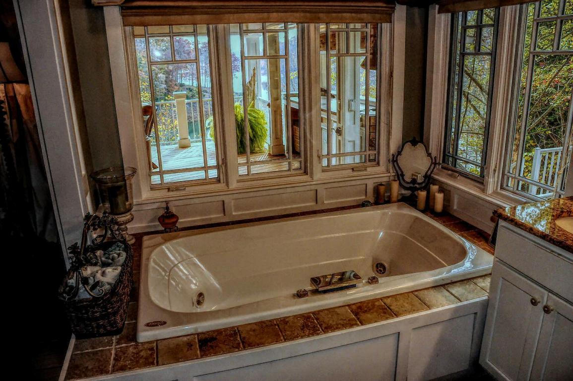 Cozy whirlpool tub with panoramic views of the mountains and lake