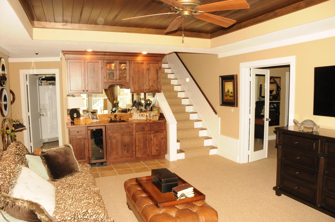 Great room with trey ceilings, bar and wine cooler