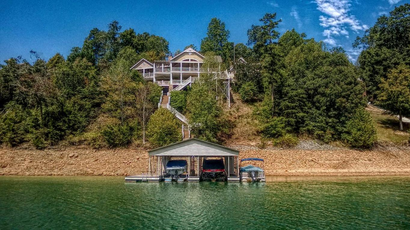 Lakefront view taken from the water at 311 Deer Ridge Lane at Deerfield Resort on Norris Lake in Lafollette, TN