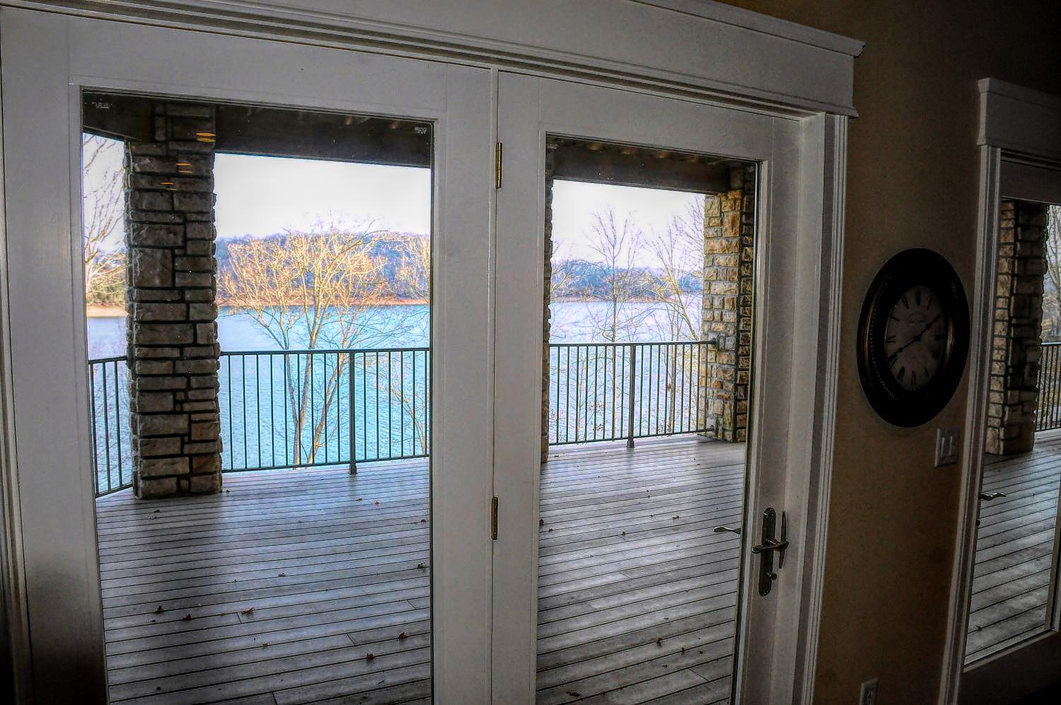 Relax on the patio deck with panoramic views of beautiful Norris Lake at Norris Crest lake community