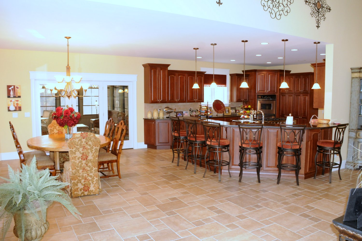 Spacious kitchen with center island and beautiful tile flooring throughout