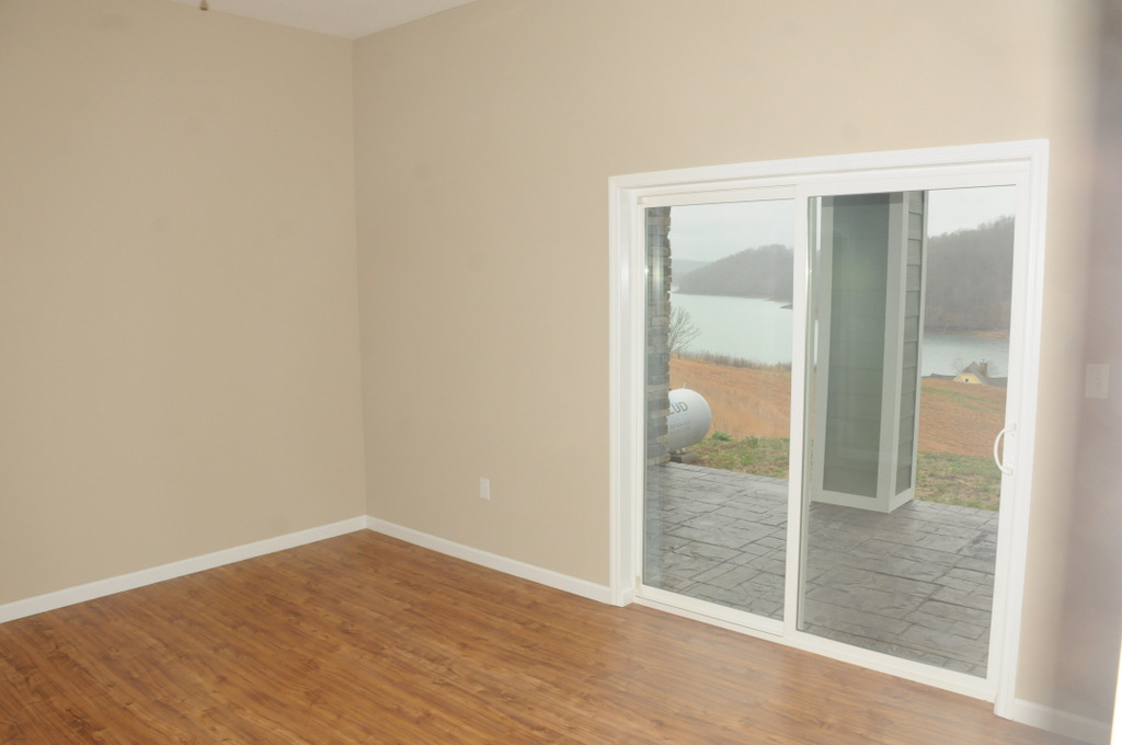 Spacious third bedroom with wood flooring and great outdoor views