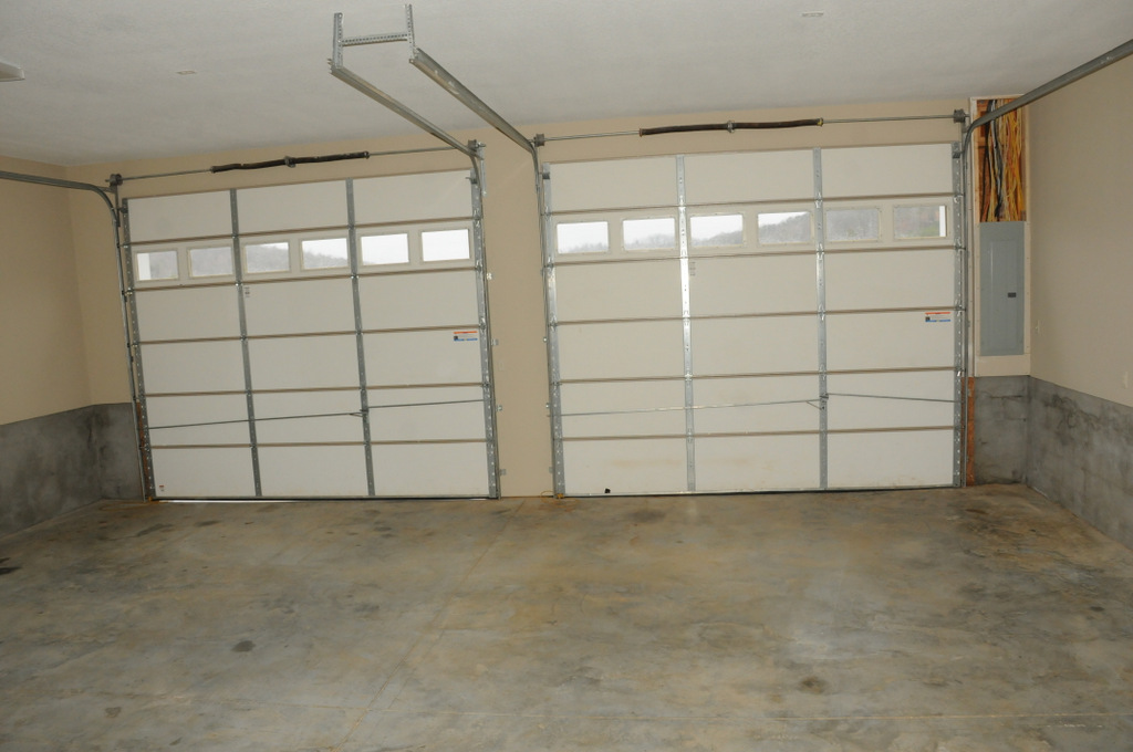 Spacious 35ft wide two car garage with plenty of space to park a wakeboard and ski boat on trailers