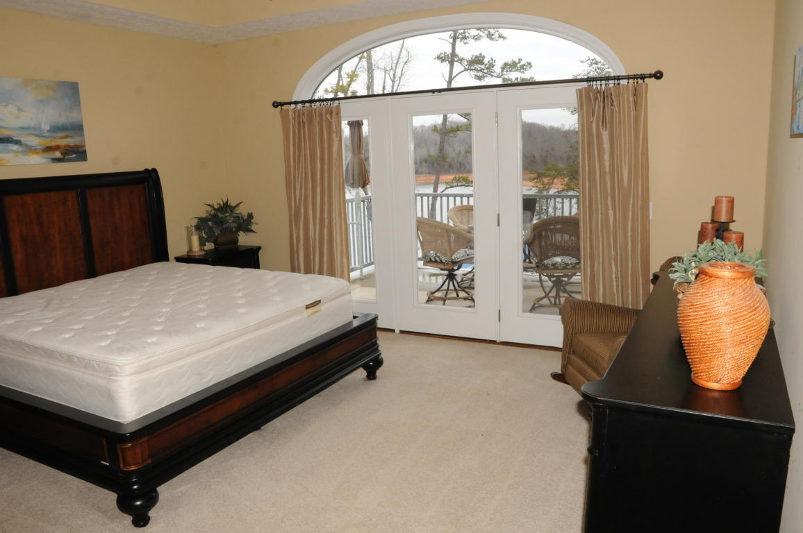 Master Bedroom with lakefront views of Norris Lake and balcony access