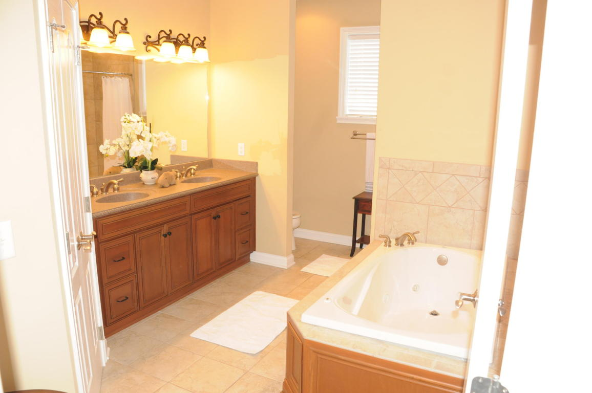 Master Bath with his/her vanity sinks and Jacuzzi hot tub
