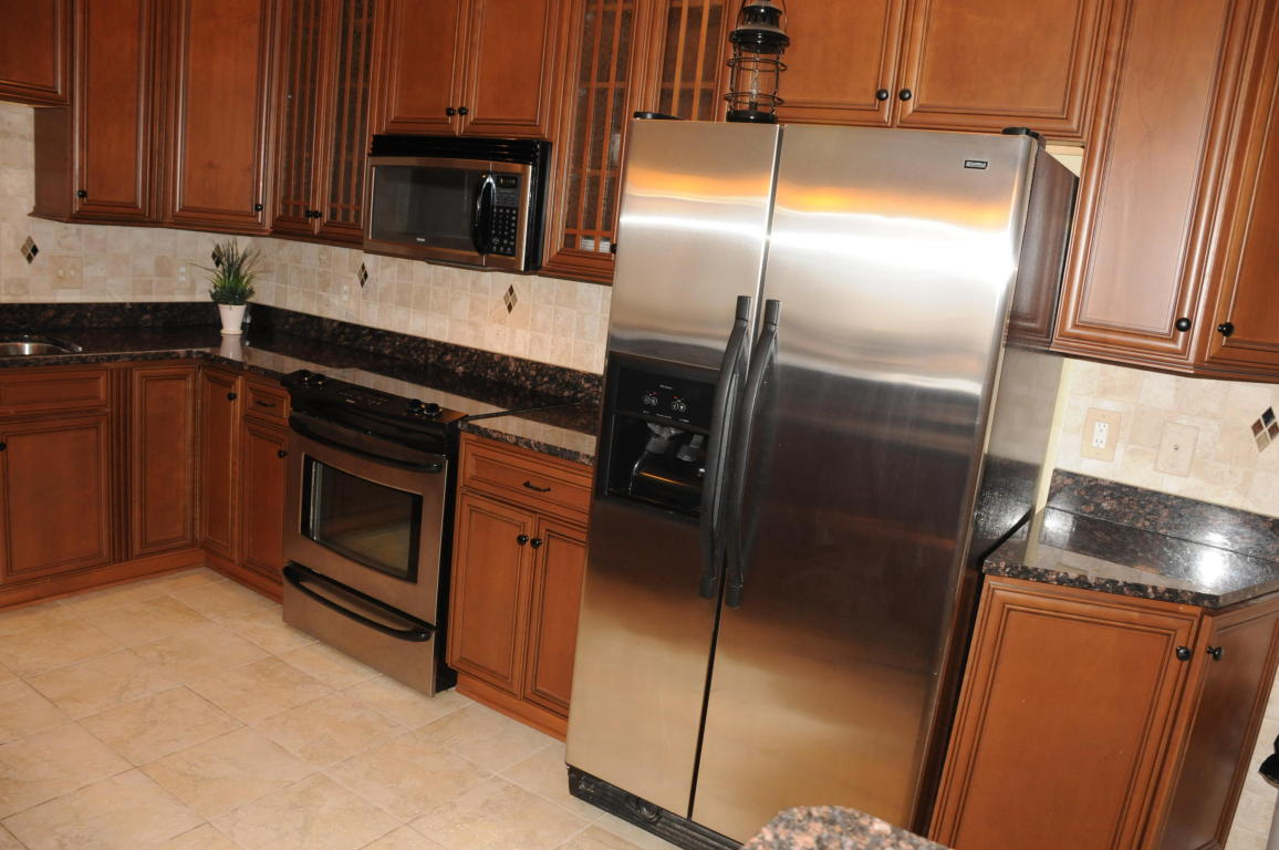 Stainless Steel microwave, refrigerator and range/oven