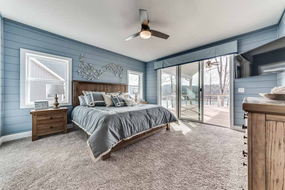 Master Bedroom with easy access to the deck and outdoor views