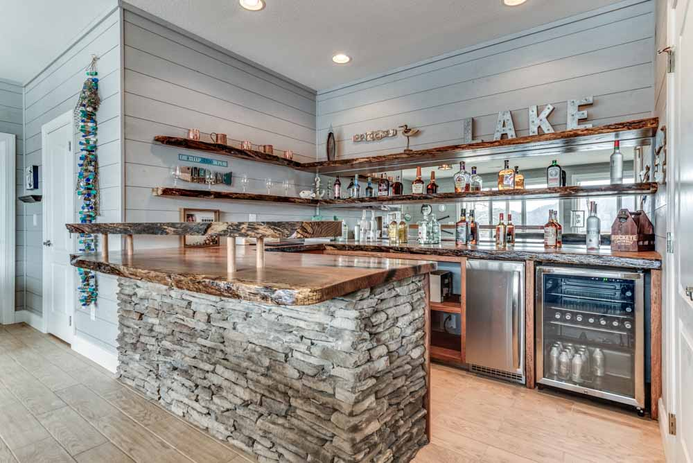 Custom wet bar with stacked stone and one-of-a-kind counter-top