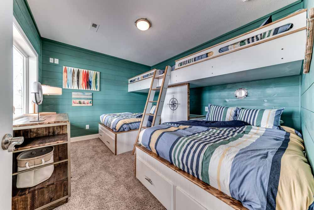 Spacious third bedroom with bunk beds offering plenty of space for the family