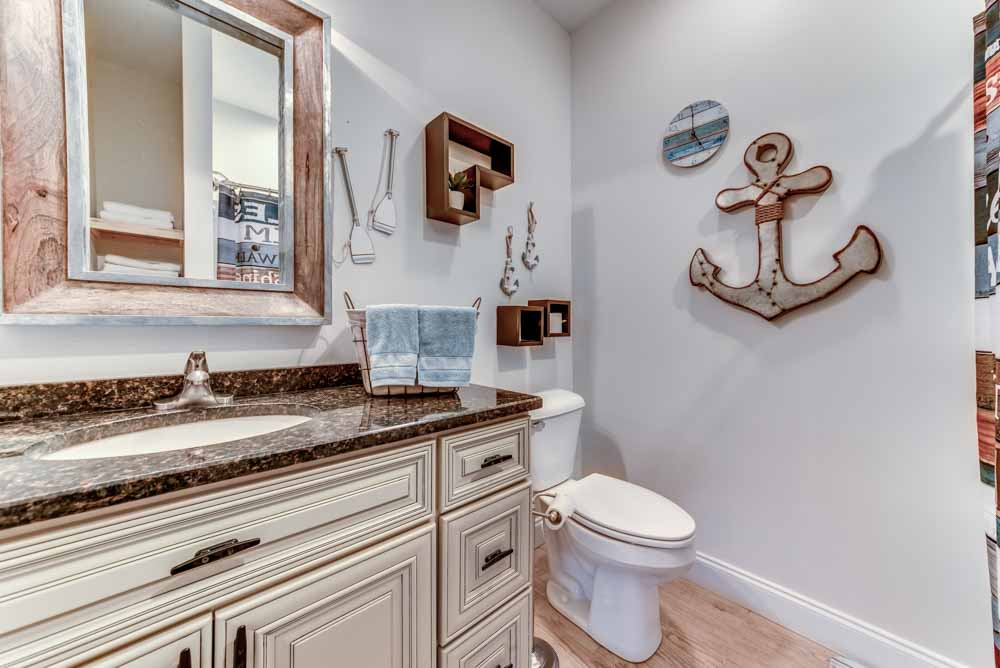 Lower level bathroom with Granite counter-tops and custom boat ties used for the hardware