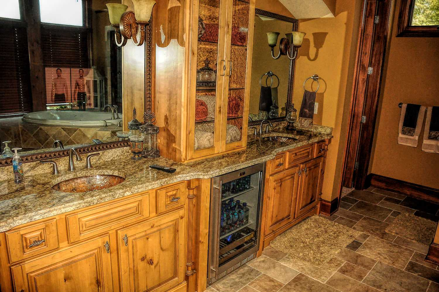 His and her separate vanity sinks with Granite top and beverage cooler