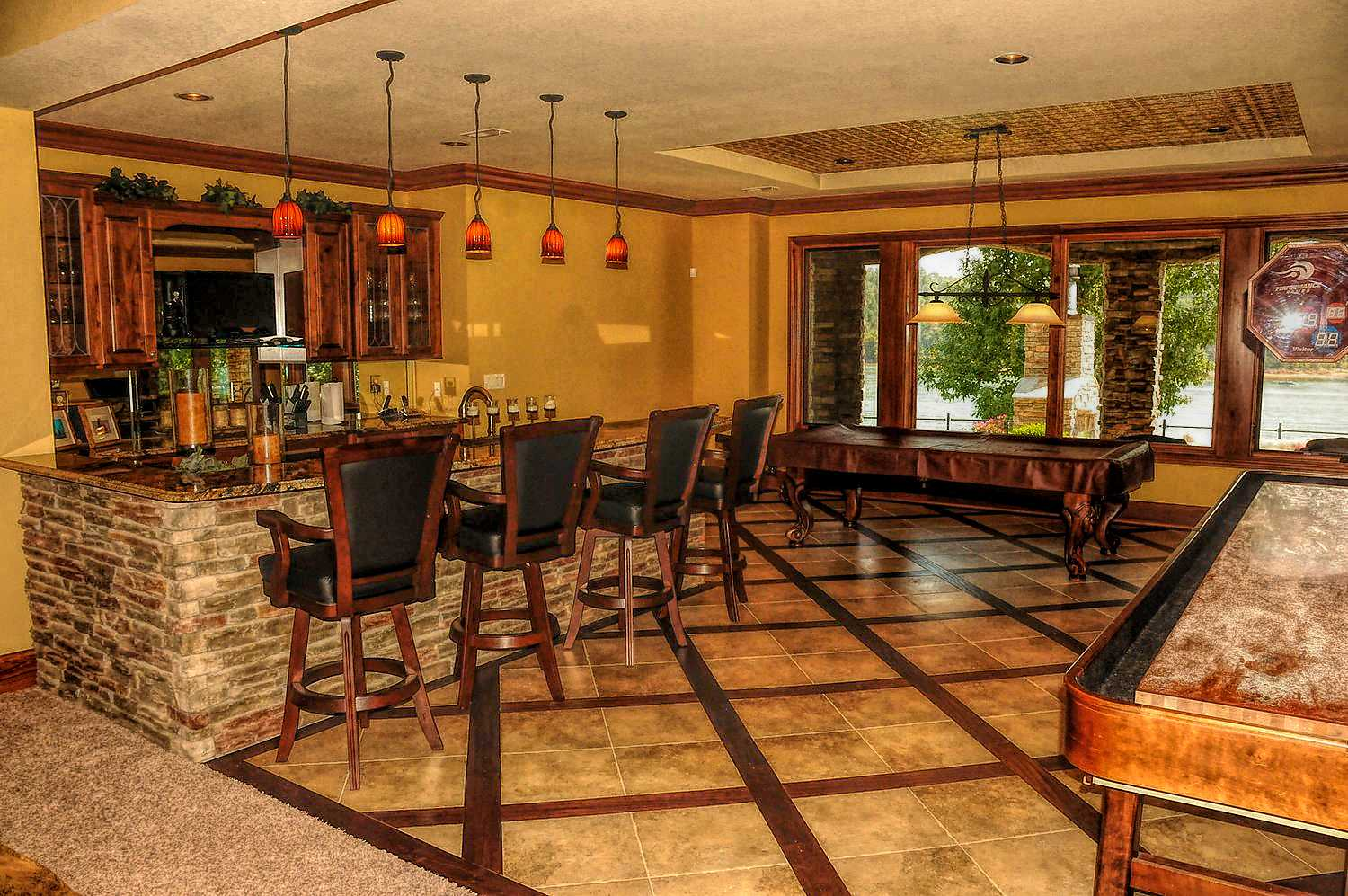 Lower level great room with full wet bar and plenty of space to entertain family and friends
